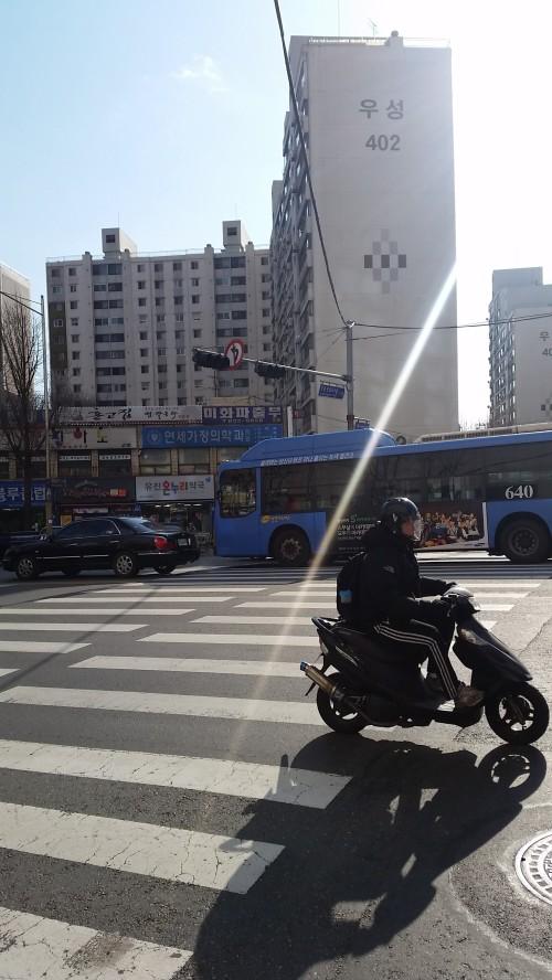 Cross the road towards block 402.