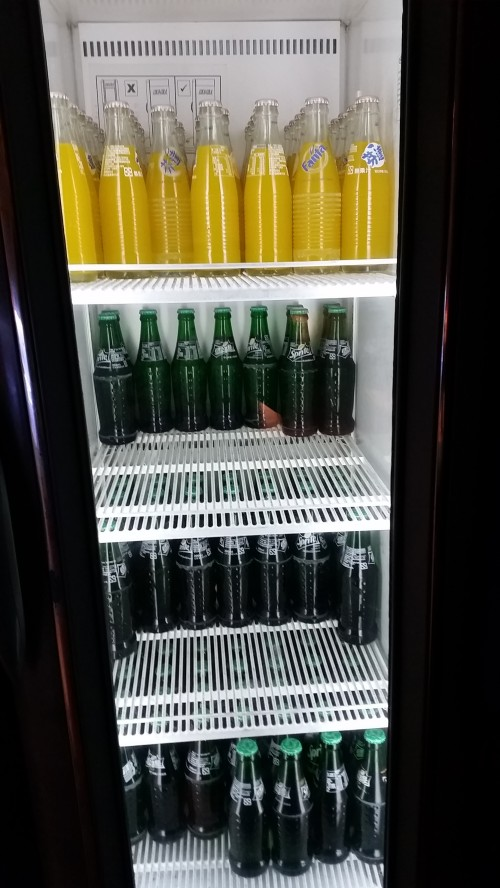 A bottle opener is placed at the left of the fridge to open the bottles.